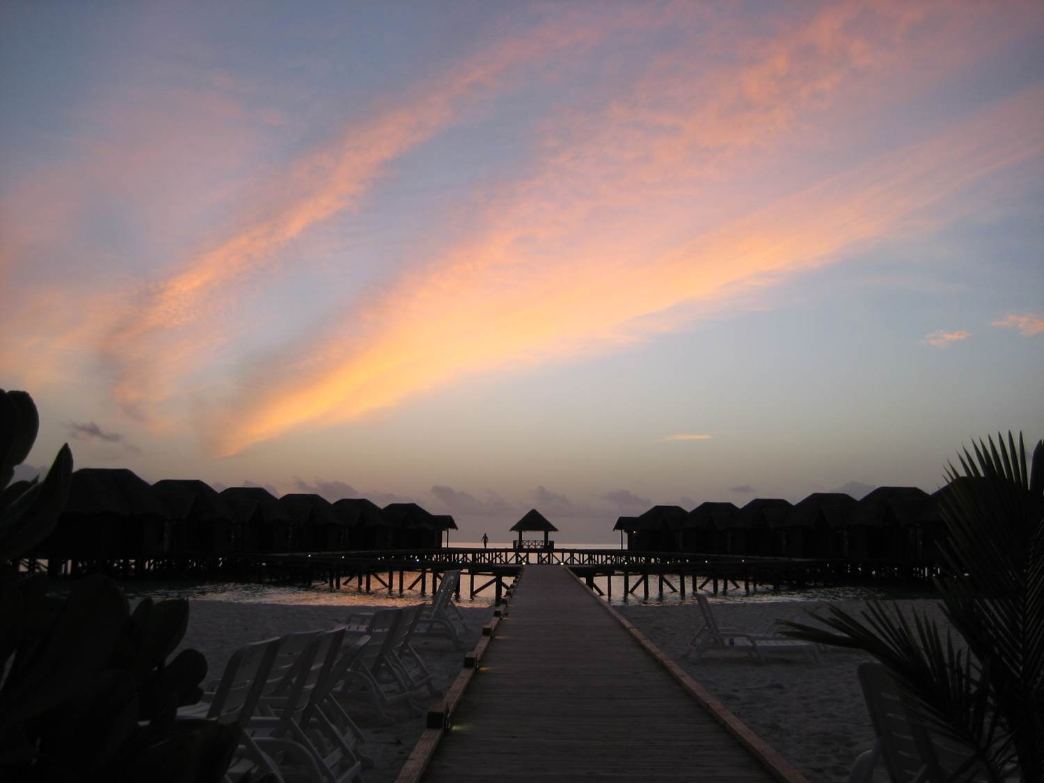 Fihalhohi Island, sunset over the water bungalows