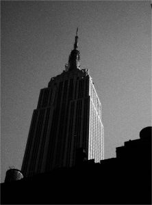 the Empire State Building, seen from the street, in black and white