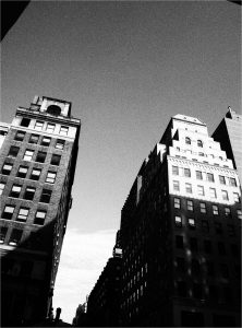 buidlings in the NYC financial district in black and white