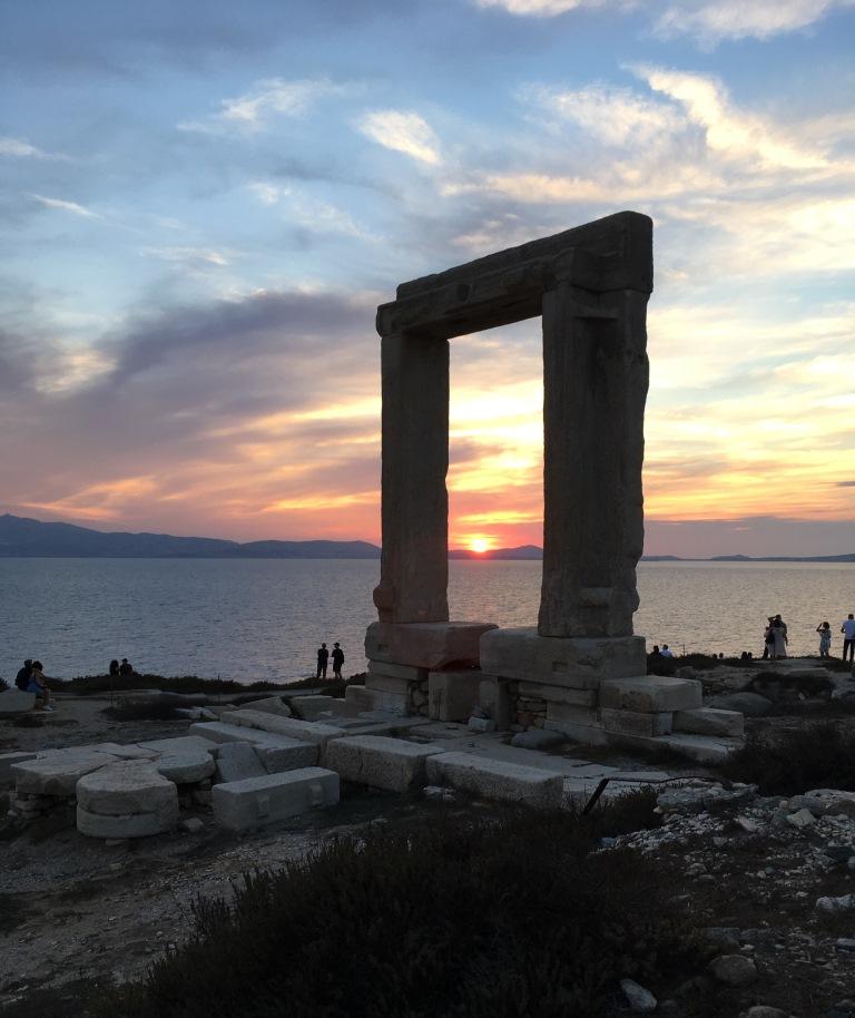 sunset over Paros behind the Portara