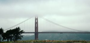 Golden Gate Bridge with upper parts in coastal fog