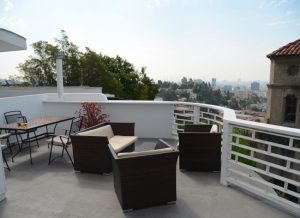 amazing rooftop terrace and a respective view of Downtown LA and Hollywood