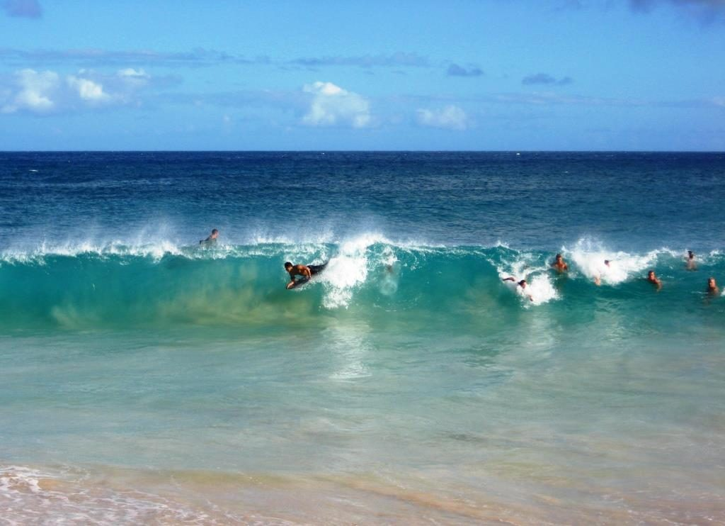 Surfers on Sandy Beach, Oahu